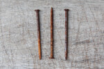 Three rusty nails that could cause tetanus, or lockjaw.