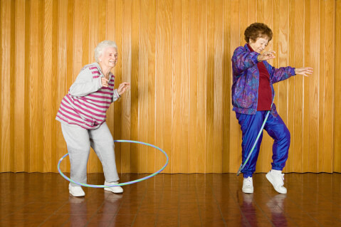Senior women hula-hooping